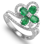 Diamond and emerald flower ring in 18k white gold